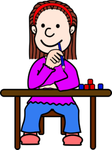 Smiling girl at desk